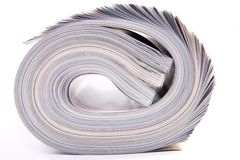 Rolled magazines stock image