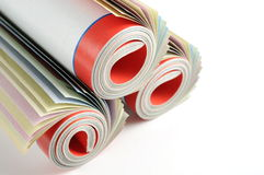 Rolled magazines background Royalty Free Stock Images