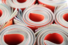 Rolled magazines background Stock Photography