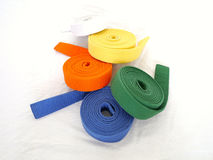 Rolled martial arts belt blue green orange yellow white Royalty Free Stock Images