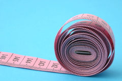Rolled measuring tape Royalty Free Stock Image