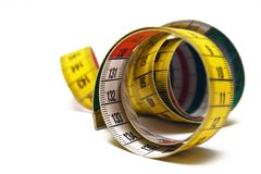 Rolled Measuring Tape. Measuring tape on a white background Royalty Free Stock Photos