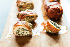 Rolled meat. Rolled chicken meat with spinach and feta cheese,selective focus Stock Photo