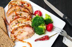Rolled meat meal with vegetables on a plate Royalty Free Stock Photography
