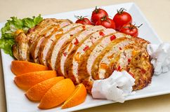 Rolled meat. Sliced Stuffed chicken meat and vegetables with oranges Royalty Free Stock Photo