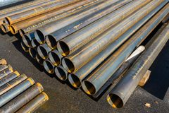 Rolled metal pipes stacked. Round ends of metal pipes, on the construction site royalty free stock photo