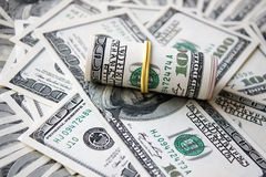 Rolled money cutout on a background dollars Stock Photo
