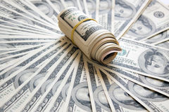 Rolled money cutout on a background dollars Royalty Free Stock Image