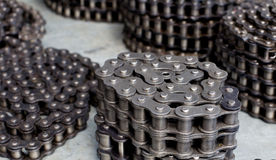 Rolled motor chains Stock Images