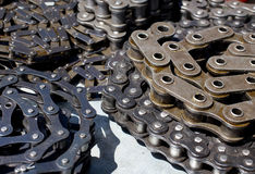 Rolled motor chains Stock Image