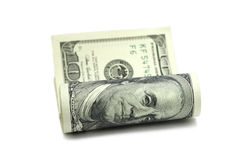 Rolled new one dollar bills Royalty Free Stock Photo