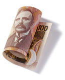 Rolled New Zealand One Hundred Dollars. A New Zealand rolled up one hundred dollar note on a white background Royalty Free Stock Photo