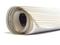 Rolled newspaper. Roll of newspaper isolated on white background Stock Photography