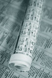 Rolled newspaper. With weather forecast over another newspaper Royalty Free Stock Photo