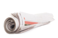 Rolled newspaper. Isolated on a white background Stock Images