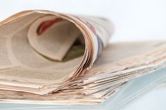 Rolled Newspaper Stock Photo