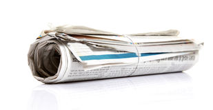 Rolled newspaper. Isolated on white background Stock Images