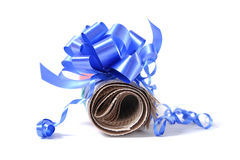 Rolled newspaper with decorative bow. Isolated on white background Stock Photo