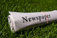 Rolled newspaper Royalty Free Stock Photos