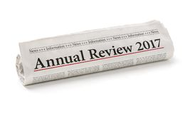 Annual review 2017. Rolled newspaper with the headline Annual review 2017 royalty free stock photography