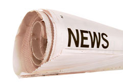 Rolled newspaper, news headline, isolated on white background Royalty Free Stock Photos
