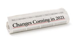 Free Rolled Newspaper With The Headline Changes Coming In 2021 Stock Photos - 199451423