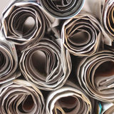 Rolled Newspapers. And Flyers on white background Royalty Free Stock Photography