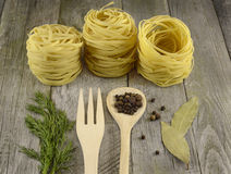Rolled noodles with spoon and fork Royalty Free Stock Photography