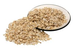 Rolled oats. In a wooden spoon on a white background Royalty Free Stock Images