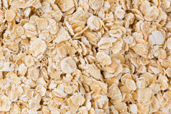 Rolled Oats. Background texture of rolled oats stock photography