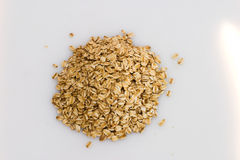 Rolled oats. A pile of organic rolled oats. Suitable for cookbook or other culinary use Stock Photo