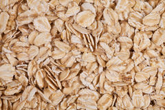 Rolled oats as background. Rolled oats forming a background Royalty Free Stock Photos