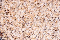 Rolled Oats Background. Dried, rolled oats ready to be made into porridge. As a background Stock Image