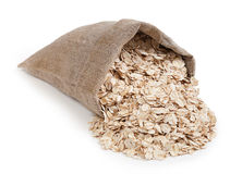 Rolled oats in a bag isolated on white background Royalty Free Stock Photos