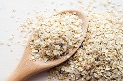 Rolled oats in big spoon stock images