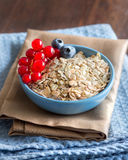 Rolled oats in a bowl with berries Royalty Free Stock Image