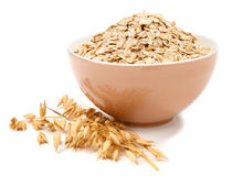 Rolled oats in a bowl isolated on white. Background Stock Images