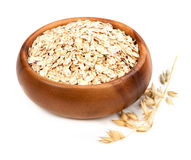 Rolled oats in a bowl isolated on white background Stock Image