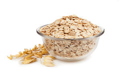 Rolled oats in a bowl isolated on white background Stock Images