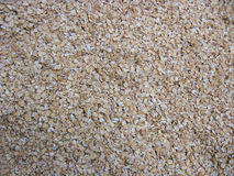 Rolled oats. Oatmeal background. Dry cereal (rolled oats, oatmeal, oat flakes). Natural background. Food background Royalty Free Stock Images