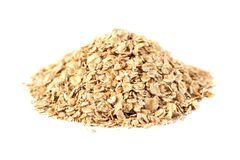 Rolled oats flakes on a white background.  royalty free stock photography