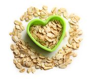 Rolled oats in heart form Stock Images
