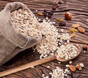 Rolled oats and nuts. Stock Photos