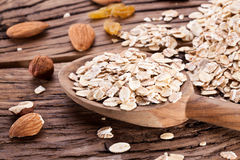 Rolled oats and nuts. Royalty Free Stock Image
