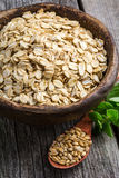 Rolled oats and oat grains Royalty Free Stock Photography