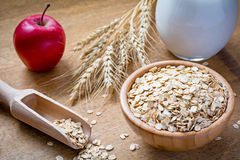 Rolled oats (oatmeal, oat flakes), milk and apple Royalty Free Stock Image