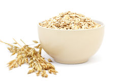 Rolled oats in a porcelain bowl Royalty Free Stock Photo