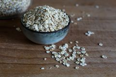 Piled oat flakes as nutritious ingredient royalty free stock photos