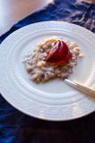 Rolled oats porridge with milk and jelly Stock Photography