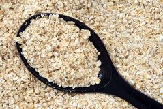 Rolled oats in a spoon Stock Image